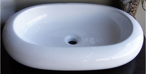Picture of Oval  ceramic basin over the counter  630 x 430 x 120 mm